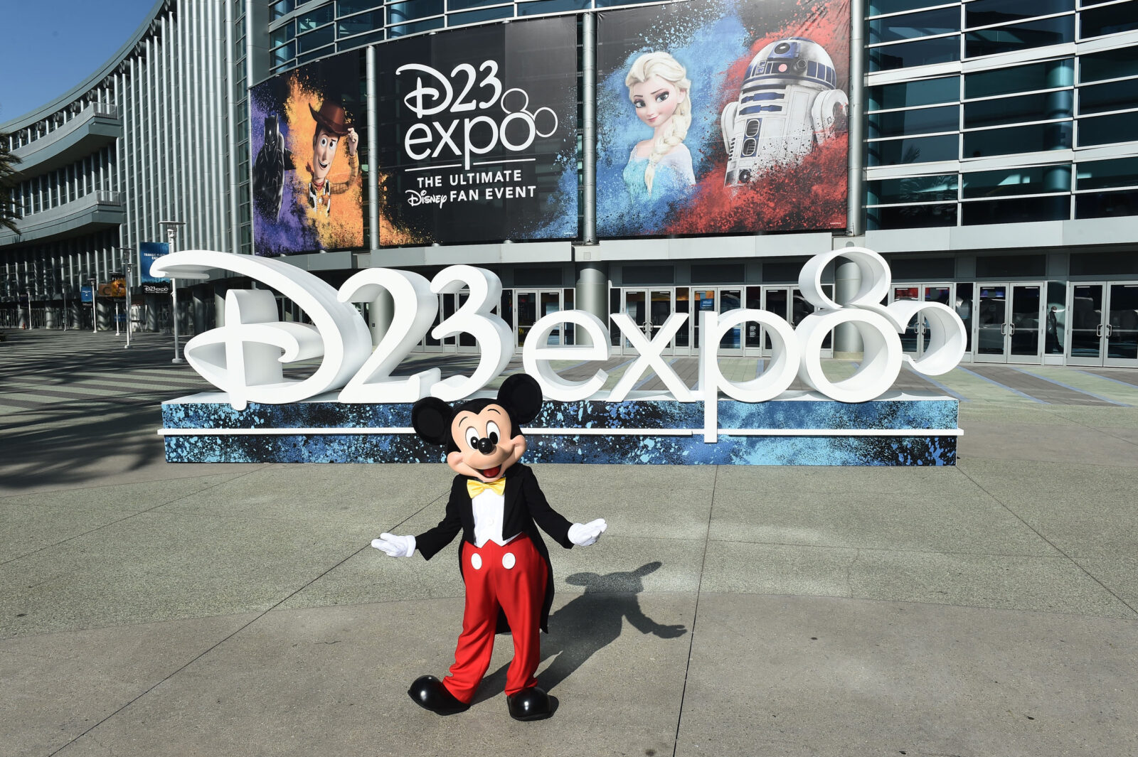 Mickey Mouse standing in front of the convention center.